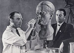 Arno Breker - Arno Breker carves a portrait of Albert Speer in 1940