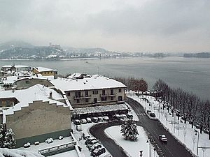 Arona, Piedmont - Largo Garibaldi in winter. The castle in the background is Angera.