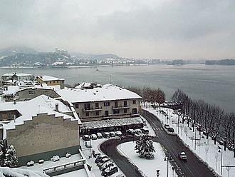 Arona, Piedmont - Largo Garibaldi in winter. The castle in the background is Angera.