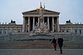 Atine statue and Austrian Parliament (8441082485).jpg