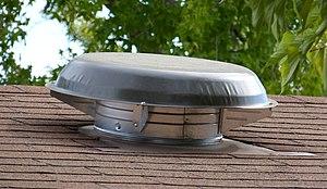 Attic fan - A weatherpoof cap covering an attic fan.