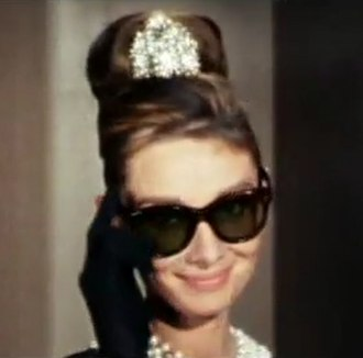 "Ray-Ban Wayfarer - The sunglasses worn by Audrey Hepburn in Breakfast at Tiffany's, although often identified as Wayfarers, are actually ""Manhattan"" by Oliver Goldsmith."
