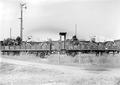 Auf der Eisenbahn verladene Materialwagen - CH-BAR - 3239643.tif