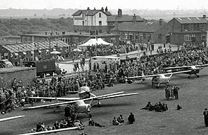 City Airport & Heliport - 1951 view of Barton Aerodrome's 1930s buildings including the Airport Hotel and farm buildings converted for passenger use. Also wartime temporary structures, now demolished