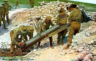 9.45-inch Heavy Mortar - Colourised postcard showing Australian Army personnel loading a mortar near Pozières – in August 1916, according to the caption. The absence of a fuse and lack of concealment indicates this is a training or publicity photograph away from the front line.