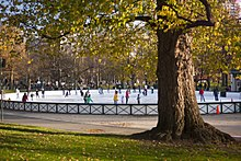 Ice skaters at Boston Common Frog Pond in downtown Boston, Massachusetts
