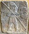 Basalt wall slab, relief, from Sam'al, Turkey, 10th-8th century BCE. Warrior holding a spear and shield. Pergamon Museum, Berlin, Germany.jpg