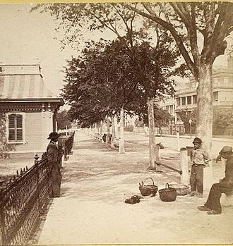 White Point Garden - Vendors are shown near Meeting and South Battery selling poultry. The Victorian pavilion and iron fence no longer exist.