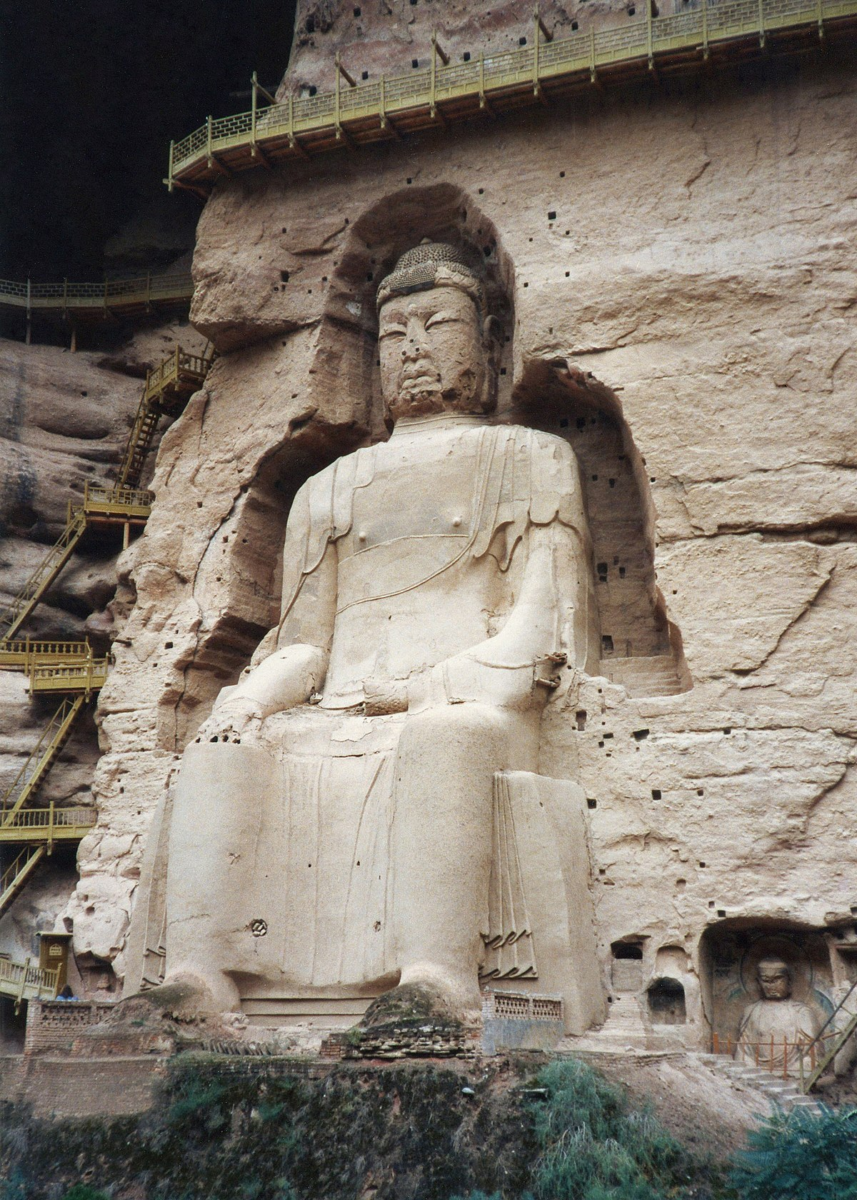 Praying Buddha In Rock Cave Figurine
