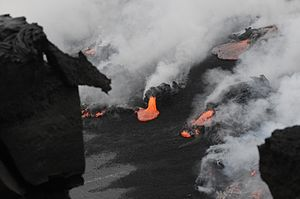 Black sand - Black sand forming when lava hits ocean. Kīlauea volcano.