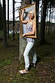 Blonde woman in a forest with a picture frame.jpg
