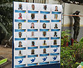 Board with photos of all victims of 4 April 2011 UN plane crash (6918519048).jpg