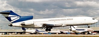 A former United States Postal Service Boeing 727-200 aircraft at Miami International Airport in 1999 Boeing 727-223(F), US Postal Service AN0236566.jpg