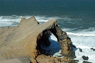 Sperrgebiet - Bogenfels (bow rock), a landmark in the Sperrgebiet. It is a 55-metre-high rock arch on the Atlantic Coast.