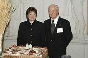 Dr. Borlaug with USDA Agriculture Secretary Ann M. Veneman near the birthday cake prepared for his 90th birthday