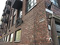 Brick building with balconies (43756501840).jpg