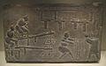 Brick relief depicting rice-husking.jpg