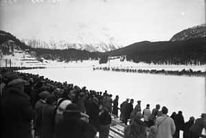 Skijoring - Demonstration skijoring competition at the 1928 Winter Olympics, horses seen in the distance, coming around the bend of the track.