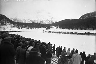 Skijoring - Demonstration skijoring competition at the 1928 Winter Olympics, horses are seen in the distance, coming around the bend of the track.