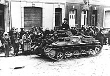 Black and white photo of soldiers with a small tank