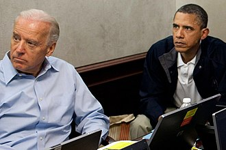Secrecy - A burn bag and security classification stickers on a laptop computer, between U.S. President Barack Obama and Vice President Joe Biden during updates on Operation Geronimo, a mission against Osama bin Laden, in the Situation Room of the White House, May 1, 2011.