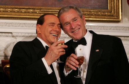 Silvio Berlusconi with United States President George W. Bush during a state dinner in honor of Berlusconi's visit to the White House. Bush and Berlusconi share toast (2008-10-13).jpg