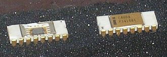 Intel 4004 - Two C4004 chips with one opened to show the die.