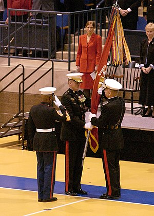 James L. Jones - Change of Command ceremony, January 13, 2003. SgtMajMC Alford McMichael (left) salutes as Gen. Jones (center) relinquishes command to Gen. Michael Hagee (right)