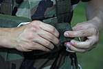 Cadet Senior Airman Jeremy Shaver, Pennsylvania Wing CAP, folds the free running end on the harness' chest strap.jpg