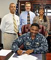 Captain Kirk R. Hibbert, CO at GTMO, signs a Domestic Violence Proclamation.jpg