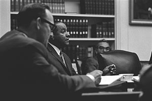 Carl Rowan - Rowan speaking at a National Security meeting on Vietnam in the Cabinet Room of the White House, July 1965.
