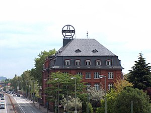 Cassella - The former headquarters of Cassella in Fechenheim, Frankfurt, with the iconic Cassella Erlenmeyer flask logo on the roof