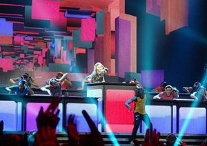 "Celebration (Madonna song) -  Madonna and her dancers performing ""Celebration"" on DJ stations at The MDNA Tour in 2012."
