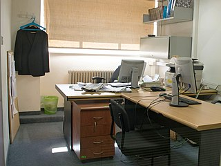 Office room where people perform their duties or a position within an organization