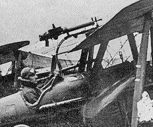 Schräge Musik - Closeup of the Foster mounting installation of a Lewis machine gun on an S.E.5a; the gun can be slid back down the curved rail for upward firing and to reload the gun's circular pan magazine