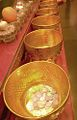 Coins left as offerings at the Buddha Tooth Relic Temple and Museum, Singapore - 20110505.jpg