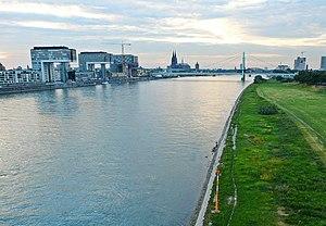 "Rheinauhafen - Rheinauhafen (left) as seen from the South: two of the three Kranhäuser already completed, ""Kranhaus1"" and ""KranhausPLUS"", designed by Hadi Teherani.  In the background: Severin Bridge and Cologne Cathedral"