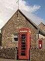 Corfe Castle, postbox No. BH20 125 and phone, East Street - geograph.org.uk - 1718578.jpg