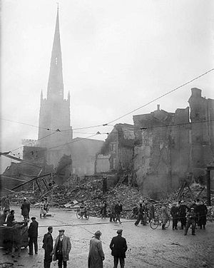Coventry Blitz - The Holy Trinity Church rises above a scene of devastation