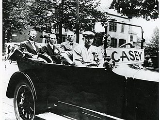 "Dan Casey - Casey (front passenger seat) in ""Casey Day"" parade, July 1915"