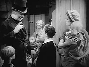 David Copperfield (1935 film) - Mr. Micawber (played by W. C. Fields) addresses young David Copperfield (Freddie Bartholomew).