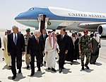 Dick Cheney, Colin Powell, and George H.W. Bush are escorted from the plane by members of the Saudi delegation.jpg