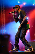 Dizzee Rascal performing on stage