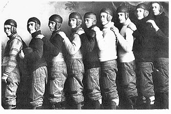 members of a football team wearing old-fashioned leather helmets