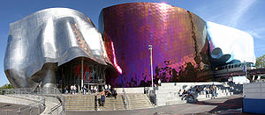 View of the EMP from the Seattle Center with the monorail traveling through it.