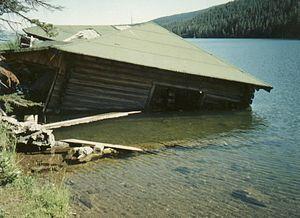 Quake Lake - Partially underwater cabin at Earthquake Lake