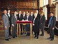 Eintrag im Goldenen Buch mit Bgm Reissmann lks v. Botschafter Frotscher im Rathaus Münster.JPG