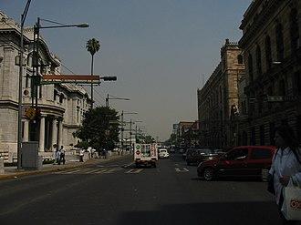 Eje Central - Eje Central looking north, with the Palacio de Bellas Artes on the left/west, and the Palacio de Correos de Mexico and Bank of Mexico on the right/east.