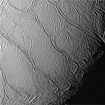 Cassini view of Enceladus's south pole. The tiger stripes, from lower left to upper right, are the Damascus, Baghdad, Cairo, Alexandria and Camphor sulci. Enceladus Tiger Stripes Up Close PIA06247.jpg