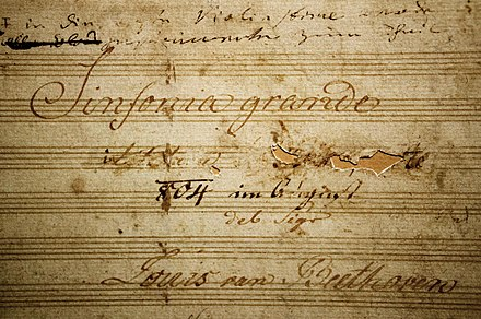Titlepage of ms. of the Eroica Symphony, with Napoleon's name scored through by Beethoven Eroica Beethoven title.jpg
